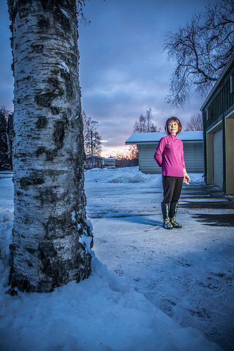 """Rental owner Christine Yi in front of her home in Bootler's Cove in Anchorage.  """"If I could be anything, I would like to be a police officer"""".  yich83@gmail.com"""