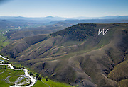 """Scenic aerial picture of Tenderfoot """"W"""" Mountain, Tomichi Creek and it's valley, looking east from Gunnison."""