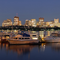 This photography image shows downtown Boston with the Boston State House and historic neighborhood Beacon Hill. The boats of the Charles River Yacht Club are in the foreground. Taken 45 to 60 minutes at twilight after sunset.<br />