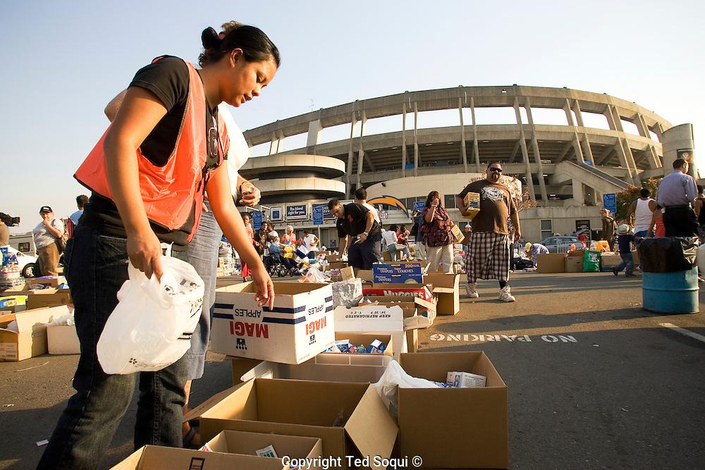Qualcomm stadium houses 12-15 thousand area evacuees. San Diego area wild fires.
