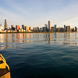 Early morning summer sun shines on the famous skyline of Chicago, IL.
