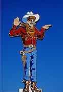"""Image of the """"Wendover Will"""" neon cowboy sign in downtown Wendover, Utah, American Southwest"""