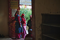 Traditionally dressed old ladies waiting at the gate of Lord Raghunath's Temple. Kullu Dussehra is the Dussehra festival observed in the month of October in Himachal Pradesh state in northern India. It is celebrated in the Dhalpur maidan in the Kullu valley. Dussehra at Kullu commences on the tenth day of the rising moon, i.e. on 'Vijay Dashmi' day itself and continues for seven days. Its history dates back to the 17th century when local King Jagat Singh installed an idol of Raghunath on his throne as a mark of penance. After this, god Raghunath was declared as the ruling deity of the Valley.