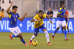 Sep 9, 2014; East Rutherford, NJ, USA; Brazil forward Neymar (10) runs with the ball past Ecuador midfielder Christian Noboa (6) during the first half at MetLife Stadium.