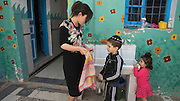 Tunisian Jewish school teacher Zahava Chouche, ,25, as she helps to dry the hands of the children in her class  at the Beit Rachel Kindergarten school located in the Hara Kebira neighborhood on the Tunisian island of Djerba on May 25,2016.  Five years after Tunisia's revolution, and a year after three deadly ISIS attacks, the 1,100 Jews in this tiny island community of Djerba say they do not feel threatened living in Tunisia.(Photo by Heidi Levine).