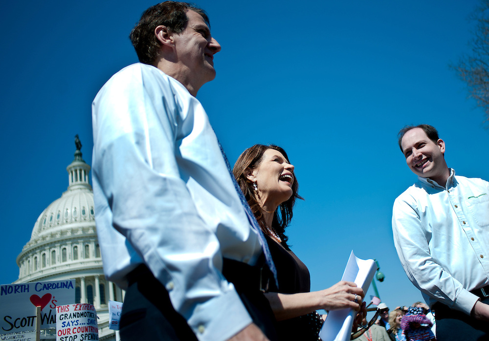 """Rep. MICHELE BACHMANN (R-MN) looks on before speaking to the crowd during a rally near the U.S. Capitol. The """"Cut Spending Now Revolt"""", staged Americans for Prosperity, was held to urge lawmakers to reduce federal spending. Americans for Prosperity describes itself as the nation's leading free-market, grassroots organization."""