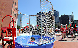 "May 19, 2012; Newark, NJ, USA; A New Jersey Devils fan celebrates ""Dunk a Ranger"" before game three of the 2012 Eastern Conference Finals at the Prudential Center."