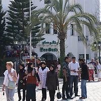Scenes from Tunisia's resort area, El Kantouai,tourists,someone headscarves