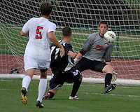 Ohio State goalkeeper Matt Lampson (28) saves a shot from Binghamton forward Jake Keegan (11) as OSU takes on Binghamton in the first half of an NCAA men's college soccer game in Columbus, Ohio on Sunday, Sept. 11, 2011, at Jesse Owens Memorial Stadium.