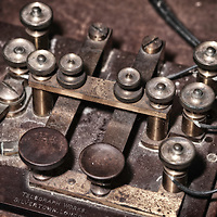 Marine telegraph Key. The left key is positive voltage (DOT) right is negative voltage (DASH). A switch in the lower left allows the key to be bypassed and the signal from the telegraph line was passed through.