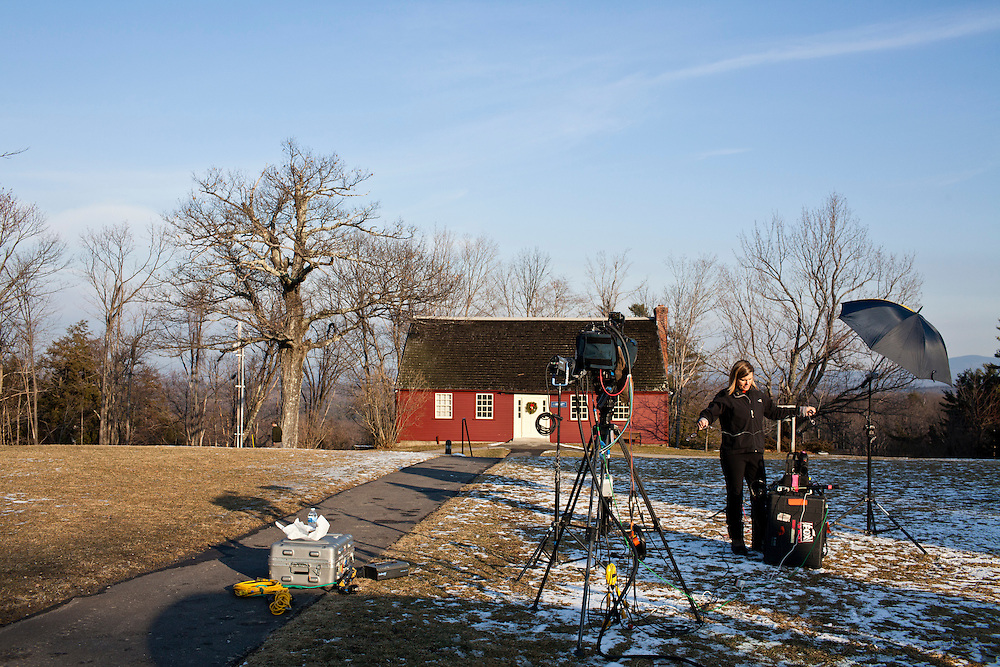 A television news crew sets up outside as Republican presidential candidate Rick Santorum speaks at a town hall meeting on Friday, January 6, 2012 in Dublin, NH.