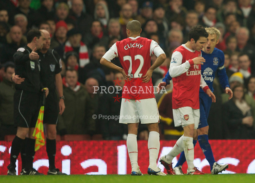 LONDON, ENGLAND - Tuesday, February 1, 2011: Arsenal's Cesc Fabregas argues with Everton's captain Phil Neville after Everton's opening goal during the Premiership match at the Emirates Stadium. (Photo by David Rawcliffe/Propaganda)