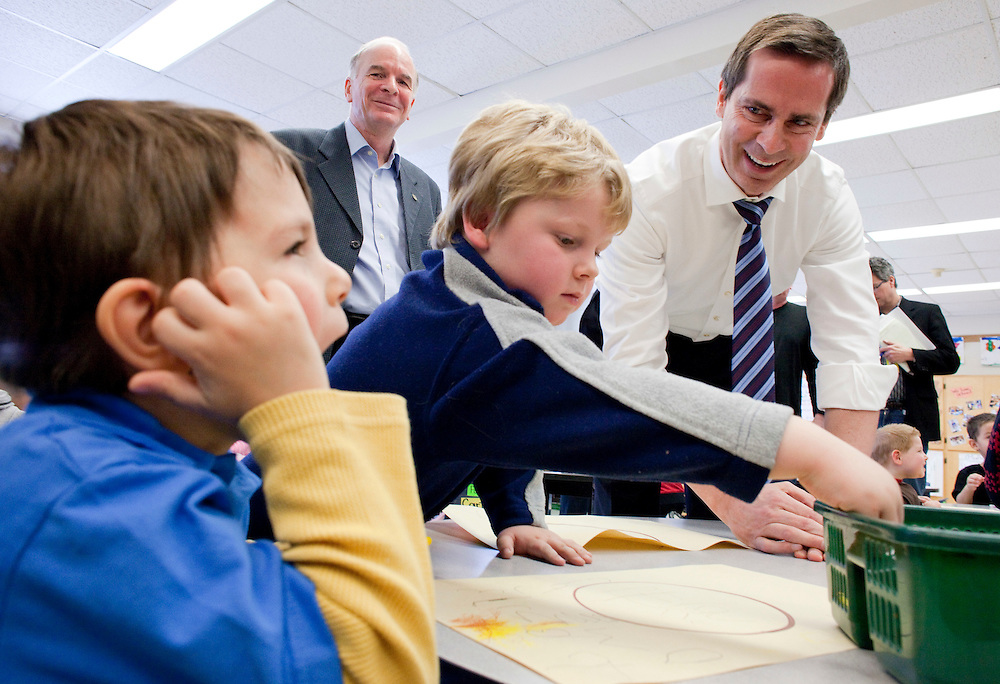 Ontario Premier Dalton McGuinty smiles at kindergarten students in Mrs. Poirier's class during a visit to Victor Lauriston School in Chatham, Ontario, January 12, 2010, where he announced the details of the government's full-day learning program program for 4 and 5 year olds.<br /> CP Photo/ GEOFF ROBINS