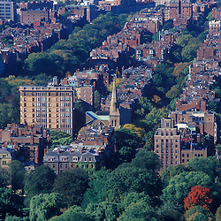Back Bay neighborhood, brownstone apartments along Commonwealth avenue and Marlboro street in late summer, Boston, MA.