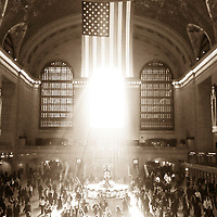 American flag in Grand Central Station with streaming morning light.