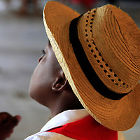Central America, Cuba, Santa Clara. Young Cuban boy in hat.