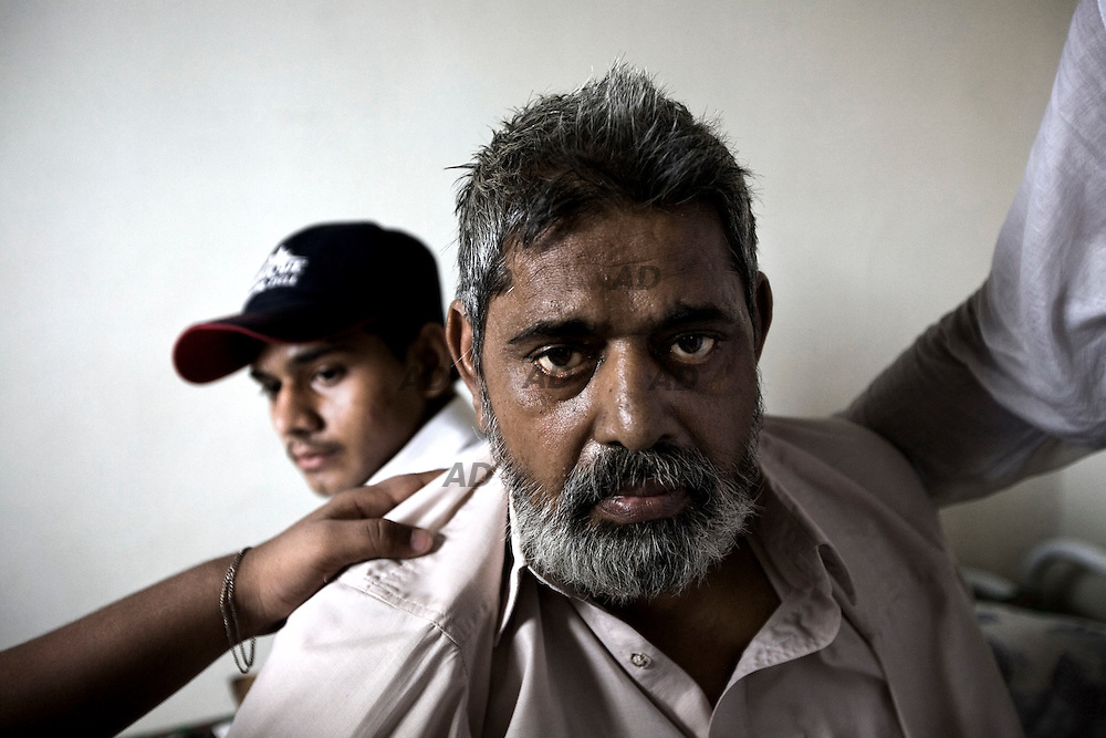 """The family of the activist of the Muttahida Qaumi Movement (MQM) 28-year-old Atiq-ur-Rehman. He was shot dead while two others were injured by unidentified assailants. No one says openly, but everyone thinks and indicate the MQM-H, the rival faction of the MQM. The father was shocked and he never leaves the house lying in bed: """" He was a good boy, he had not hurt anyone."""", he said. Behind him, the son and brother of the dead. *** General Caption *** Muttahida Quami Movement, generally known as MQM , (""""United National Movement"""" in English) is an progressive liberal secular centre left party in Pakistan (initially on quasi-socialist lines) founded on 11 June 1978 as a student organization of """"muhajir"""" (immigrants), the  All Pakistan Muhajir Students Organization or APMSO, at the University of Karachi by Altaf Hussain who continues to remain its chief. Supposedly it represent the majority of immigrants who migrated from India to Pakistan in 1947. APMSO then gave birth to the Muhajir Quami Movement (MQM) on March 1984. From 1992 to 1994, the MQM was the target of the Pakistan Army's Operation Cleanup leaving hundreds of civilians dead. On July 26, 1997, MQM officially removed the term Muhajir from its name, and replaced it with Muttahida (""""United""""). In 1992, after the operation """"Clean up"""", there was the split with key members of the party: the MQM-H or MQM Haqiqi, the """"real"""" MQM, was born. Since then have not stopped the target killing from both sides. The target killing is getting intensified in Karachi with the military's ongoing counterinsurgency operation in Swat and Malakand. The MQM party is, maybe, the worst enemy of the taliban in Pakistan."""