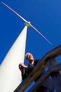 TORONTO, ON: January 10, 2006 -- IAN BAINES OF CONTROLTECH ENGINEERING --  Ian Baines of Controltech Engineering Inc. poses for a picture underneath Toronto Hydro's experimental wind turbine on the CNE grounds January 10. Baines was the driving force behind the plans for a wind turbine farm on Wolf Island.&amp;#xA;&amp;#xA;&amp;#xA;Steve McKinley photo.<br />
