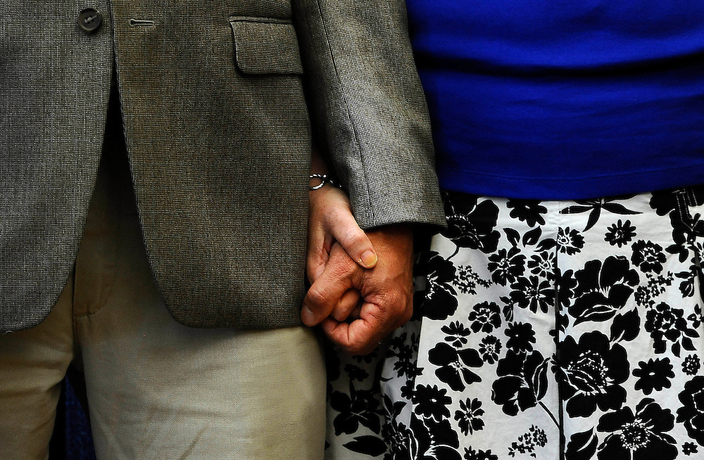 Mark and Jackie Barden, parents of Sandy Hook School shooting victim Daniel Barden hold hands during a news conference at the Capitol in Hartford, Conn., Friday, May 31, 2013.  Family members of the school shooting victims are making a last-minute appearance at the state Capitol to urge Connecticut legislators to pass a bill that would block the public release of crime scene photos and other records from the massacre. (AP Photo/Jessica Hill)