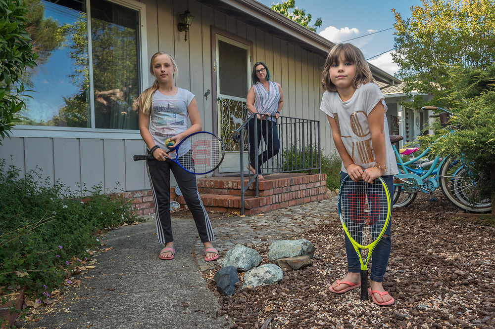 Esthetician Jen Freutel with her daughters, Skylar (11) and Hayden (7) in front of their home in Calistoga