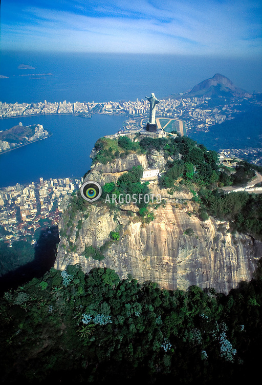 Rio de Janeiro, RJ, Brasil..Vista aerea do Cristo Redentor e Lagoa Rodrigo de Freitas, Zona Sul do Rio. Aerial View of Christ the Redeemer and Rodrigo de Freitas lake. Christ the Redeemer (Portuguese: O Cristo Redentor), is a statue of Jesus Christ in Rio de Janeiro, Brazil. The statue stands 39.6 metres (130 feet) tall, weighs 700 tons, and is located at the peak of the 700-m (2296-foot) Corcovado mountain in the Tijuca Forest National Park overlooking the city