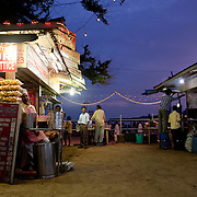 Street food stalls on Chowpati beach in Mumbai offer a variety of favorite snacks like Pani puri, Bhel puri, Sev Puri and more.
