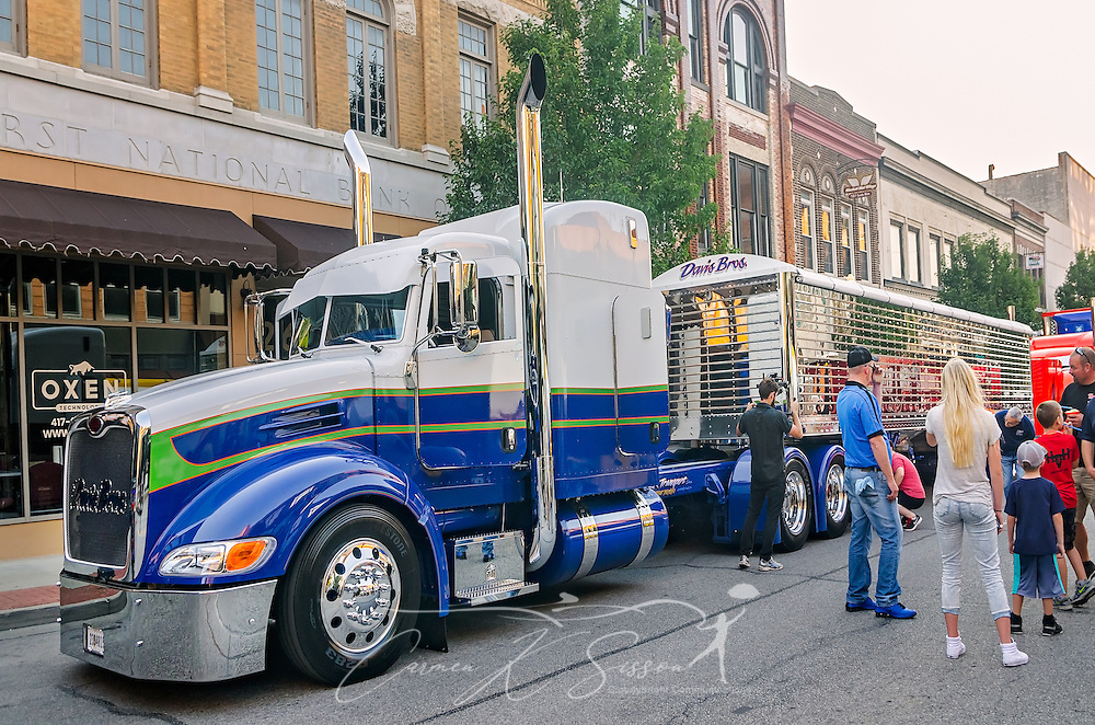 "People look at ""Buzz Kill,"" a 2015 Peterbilt 386 with a 2016 Wilson DH501 trailer, during the 34th annual Shell Rotella SuperRigs parade, June 10, 2016, in Joplin, Missouri. SuperRigs, organized by Shell Oil Company, is an annual beauty contest for working trucks. Approximately 89 trucks entered this year's competition. ""Buzz Kill,"" owned by Davis Bros., received the show truck award during the 2016 SuperRigs. (Photo by Carmen K. Sisson/Cloudybright)"