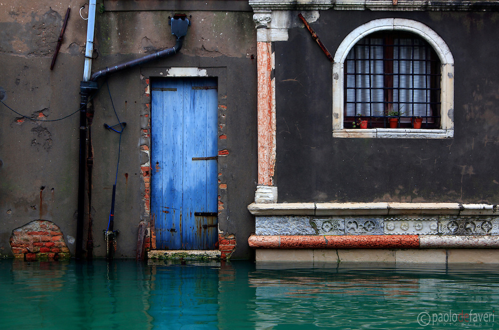 """A small blue door of Palazzo Mastelli, also knows as Palazzo del Cammello or, in venetian dialet """"caxa del Camelo (camel's house) is a building on the Rio Madonna dell'Orto, a canal in Venice, Italy"""
