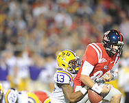 LSU cornerback Ron Brooks (13) sacks and recovers a fumble by Ole Miss' Zack Stoudt (8) at Vaught-Hemingway Stadium in Oxford, Miss. on Saturday, November 19, 2011.