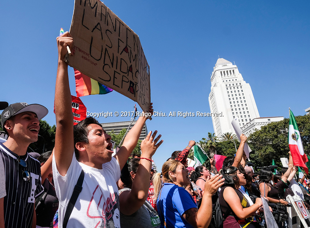 May Day protesters and a group of President Donald Trump supporters taunt each other as they are separated by police officers during the annual May Day March in Los Angeles, May 1, 2017. (Photo by Ringo Chiu/PHOTOFORMULA.com)<br /> <br /> Usage Notes: This content is intended for editorial use only. For other uses, additional clearances may be required.