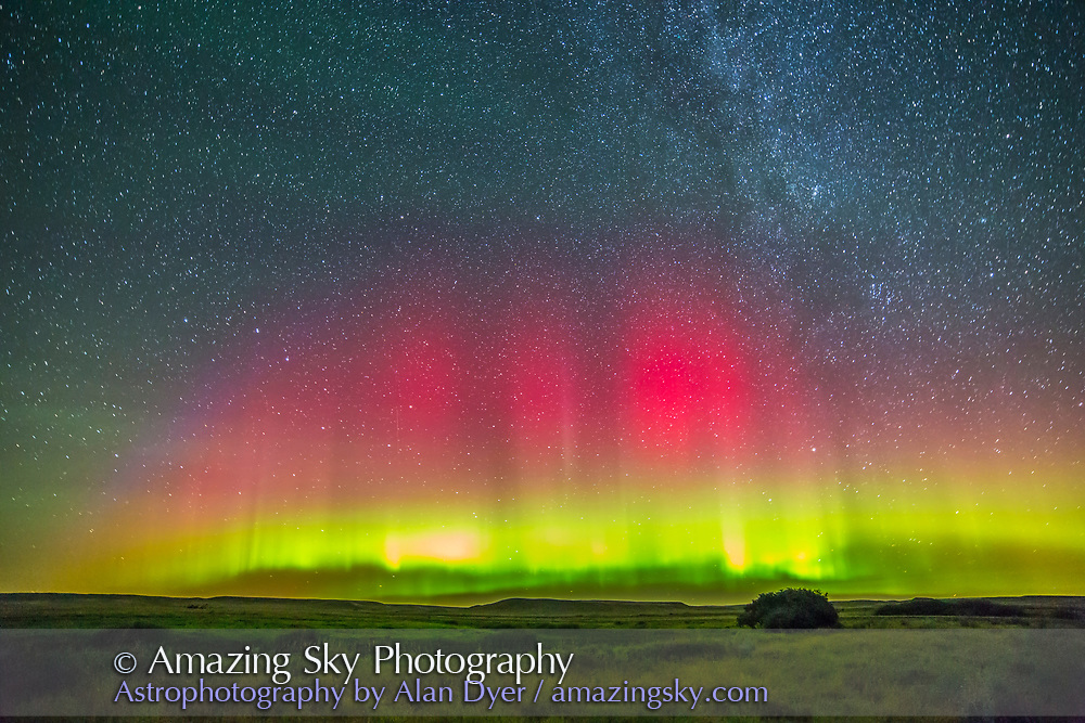 The aurora borealis in a mild display AUgust 26/27, 2014 as shot from Grasslands National Park in Saskatchewan. This is a single frame from a 200-frame time-lapse taken with the Canon 6D and Rokinon 14mm at f/2.8 and for 60 seconds at ISO 5000, making the bright parts of the display overexposed here (shortly after this, as the aurora brightened I cut back the exposure).
