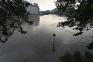 Paris . Flooding . The Seine river  Paris city center. Saint Louis island quay under the water
