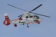 Sysselmannen helicopter patrols northernmost ski marathon in the world outside Longyearbyen on Spitsbergen island in April; Svalbard, Norway.