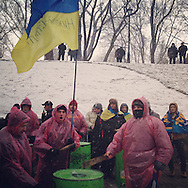 Wet heavy snow brings out the latest in revolutionary fashion, Dec. 6, 2013. #kiev #київ #україна #ukraine #евромайдан #primecollective