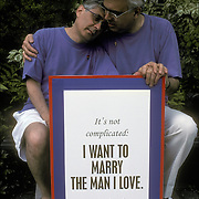"Gay couple David and David living together for 20 years with sign, ""Want to Married the Man I Love"" "" Want it Legal"" at Gay rights protest march in New York City.."