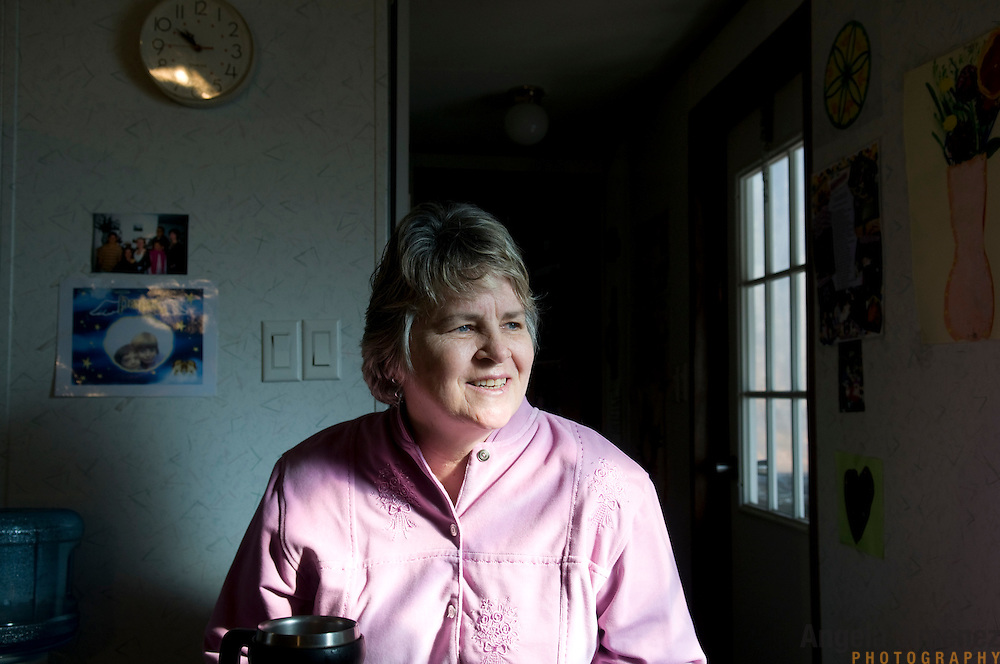 """Date: 1/09/09.Desk: STL.Slug: WOMYN.Assign ID: 30074969A..Morgana MacVicar, 61, during breakfast at another resident's home at Alapine, a """"womyn's land"""" or lesbian intentional community, in rural northeast Alabama. ..(*the exact town/location of the community cannot be revealed in the caption or article, per agreement with the subjects)..Photo by Angela Jimenez for The New York Times .photographer contact 917-586-0916"""