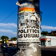 """SHOT 8/3/09 7:14:42 PM - Old adverstisements for events on a street pole along Colfax Avenue in Denver, Co. Colfax Avenue is the main street that runs east and west through the Denver-Aurora metropolitan area in Colorado. As U.S. Highway 40, it was one of two principal highways serving Denver before the Interstate Highway System was constructed. In the local street system, it lies 15 blocks north of the zero point (Ellsworth Avenue, one block south of 1st Avenue). For that reason it would normally be known as """"15th Avenue"""" but the street was named for the 19th-century politician Schuyler Colfax. On the east it passes through the city of Aurora, then Denver, and on the west, through Lakewood and the southern part of Golden. Colfax Avenue cuts through Original Aurora, the city's historic core, and skirts the southern edge of downtown Denver. Because of the dense, mixed-use character of the development along Colfax Avenue, the Regional Transportation District bus route 15 - East Colfax has the highest ridership in the RTD system. Colloquially, the arterial is referred to simply as """"Colfax"""", a name that has become associated with prostitution, crime, and a dense concentration of liquor stores and inexpensive bars. Playboy magazine once called Colfax """"the longest, wickedest street in America."""" However, such activities are actually isolated to short stretches of the 26-mile (42 km) length of the street. Periodically, Colfax undergoes redevelopment by the municipalities along its course that bring in new housing, trendy businesses and restaurants. Some say that these new developments detract from the character of Colfax, while others worry that they cause gentrification and bring increased traffic to the area.(Photo by Marc Piscotty / © 2009)"""