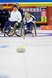 PINEROLO, ITALY - MARCH 15th : Angie Malone of Great Britain releases a stone during the last round-robin match of the curling competition between Great Britain and the USA during Day 5 of the Turin 2006 Winter Paralympic Games on March 15th, 2006 at the Pinerolo Palaghiaccio Stadium in Turin, Italy.