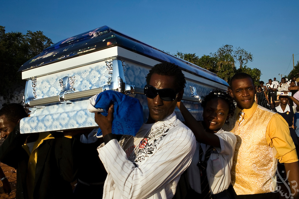 A casket carrying  the body of Shevon Johnson (age 16) is taken for burial by school mates and family members to the Dovecott cemetery in Spanish Town December 14, 2008. Johnson was stabbed to death by a classmate after a disagreement over a cell phone at the Dunoon Technical High School in Kingston, Jamaica November 17, 2008. Violence in Jamaican schools has increased along with the overall rates of violence in murder in Jamaica.