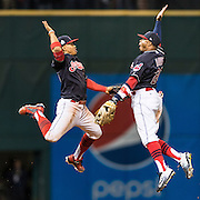 CLEVELAND, OH - OCTOBER 25, 2016: Francisco Lindor #12 and Rajai Davis #20 of the Cleveland Indians celebrate on the field after the Cleveland Indians defeat the Chicago Cubs during Game 1 of the 2016 World Series at Progressive Field on October 25, 2016 in Cleveland, Ohio. (Photo by Jean Fruth)