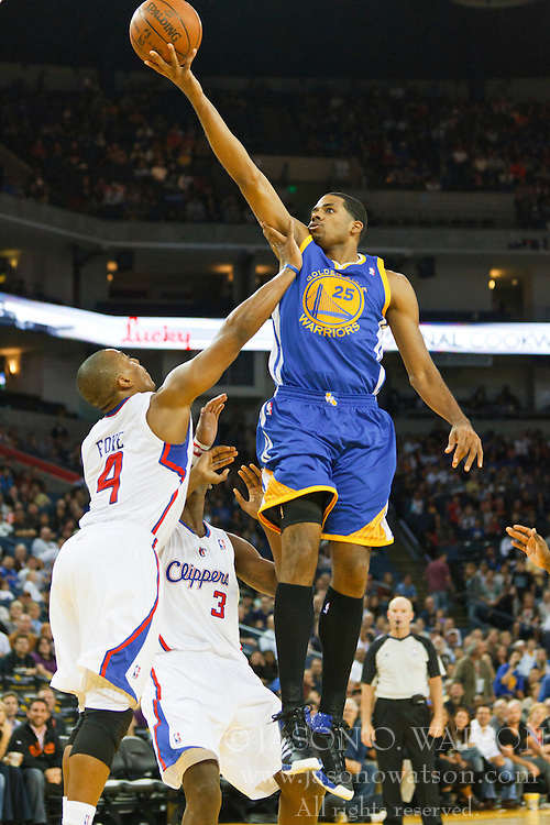 October 29, 2010; Oakland, CA, USA;  Golden State Warriors small forward Rodney Carney (25) is fouled by Los Angeles Clippers guard Randy Foye (4) while shooting during the fourth quarter at Oracle Arena. The Warriors defeated the Clippers 109-91.