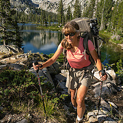 ID00625-00...IDAHO - Hiker at Alice Lake in the Sawtooth Wilderness, Sawtooth National Recreation Area. (MR# S1)
