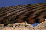 A large hole is dug under the US-Mexico border fence near Tecate, Mexico on Wednesday, April 12, 2006.<br />