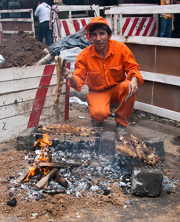 A Buenos Aires municipal worker makes himself a steak for lunch. He invited me to join. It was the best grilled beef on the streets of Buenos Aires.