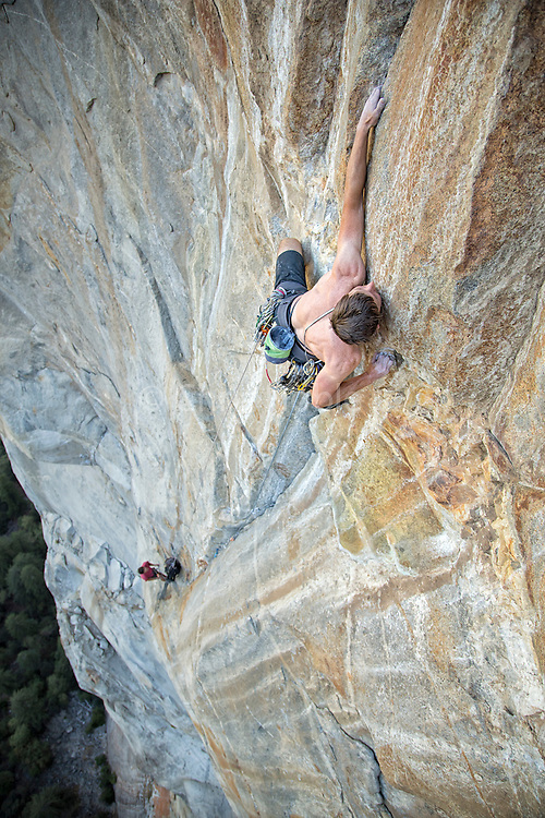 "Belayed by Alex Honnold, Tommy Caldwell climbs the third pitch (13a/b) of Todd Skinner's route ""Wet Lycra Nightmare,"" on Leaning Tower, Yosemite National Park."