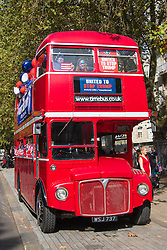 "London, September 21st 2016. A ""Stop Trump"" open topped red London double-decker bus tours central London in a bid to encourage US expats to register to vote, expecting the majority of them to be more inclined to support for Hilary Clinton."