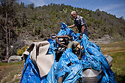 Gold miner James Butler uncovers his mining dredge that has been banned on his mining claim on the Yuba River in the Sierra foothills near Smartsville, California, April 19, 2012..CREDIT: Max Whittaker/Prime for The Wall Street Journal.MINER