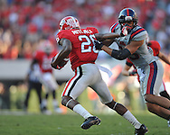 Georgia cornerback Malcolm Mitchell (26) is tackled by Ole Miss defensive back Cody Prewitt (25) at Sanford Stadium in Athens, Ga. on Saturday, November 3, 2012.
