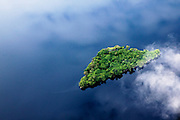 A small island in Lake Mai-Ndombe is revealed through the cloud cover in central region of the Democratic Republic of Congo, May, 2009.