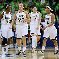 SOUTH BEND, IN - FEBRUARY 11: Members of the Notre Dame Fighting Irish walk up court during the game against the Louisville Cardinals at Purcel Pavilion on February 11, 2013 in South Bend, Indiana. Notre Dame defeated Louisville 93-64. (Photo by Michael Hickey/Getty Images)
